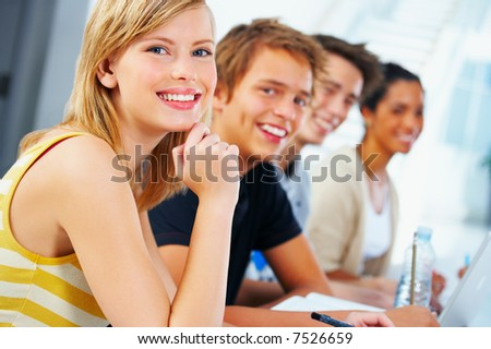http://image.shutterstock.com/display_pic_with_logo/2700/2700,1196709343,1/stock-photo-portrait-of-a-beautiful-young-student-taken-during-their-study-group-7526659.jpg