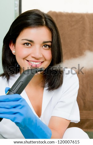 Portrait of a beautiful young woman cleaning with steam
