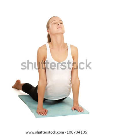 Portrait of a beautiful young woman doing yoga exericise against white background