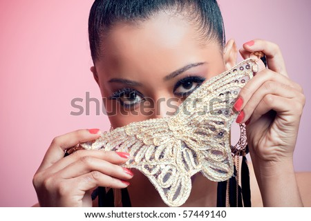 Portrait of a beautiful young woman holding a butterfly
