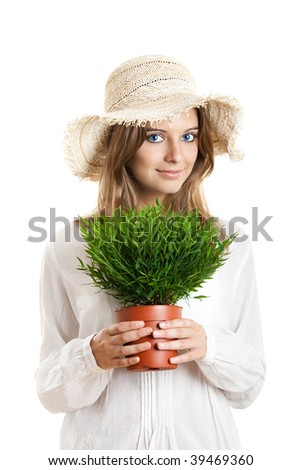 Portrait of a beautiful young woman holding a plant on her hands