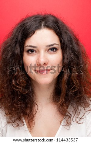 portrait of a beautiful young woman in front of a gray background - Shutterstock ID 114433537
