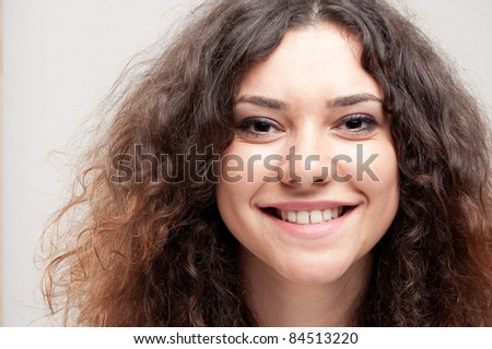 portrait of a beautiful young woman in front of a gray background