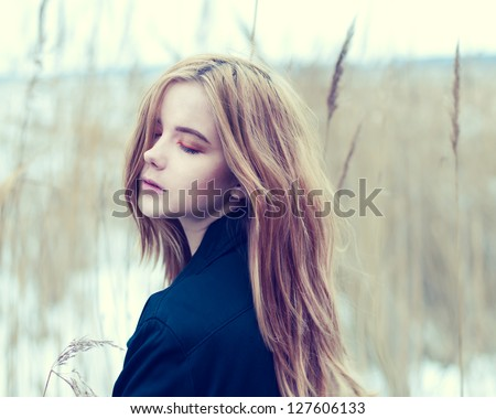 portrait of a beautiful young woman in nature