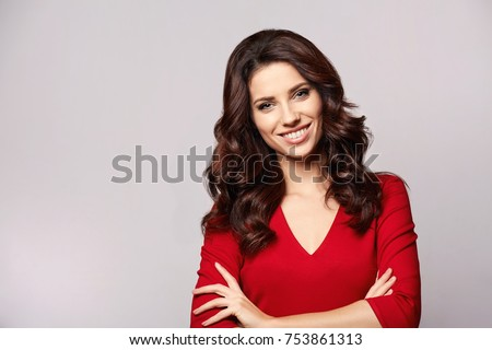 Stock Photo Portrait of a beautiful young woman in red dress