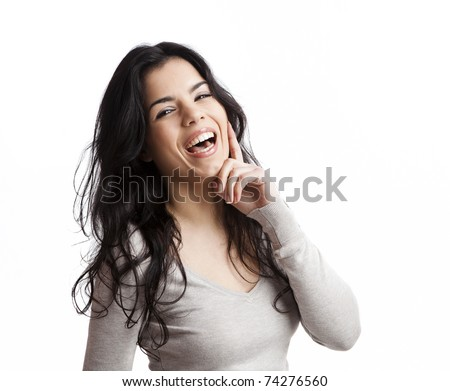Portrait of a beautiful young woman laughing, isolated over white background - stock photo