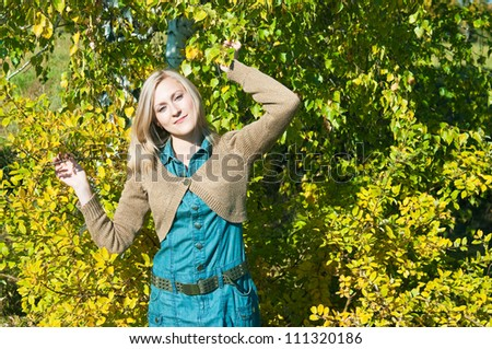 Portrait of a beautiful young woman posing near a tree