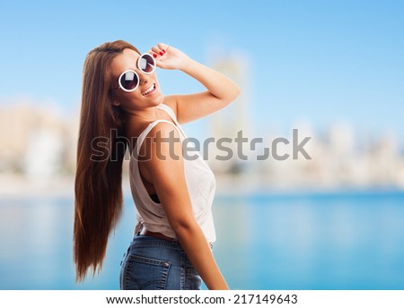 portrait of a beautiful young woman posing with sunglasses #217149643