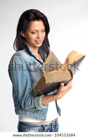 Portrait of a beautiful young woman reading a book