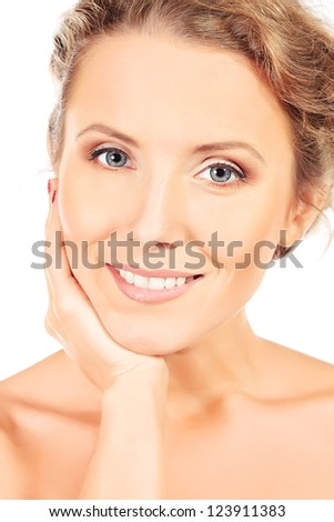 Portrait of a beautiful young woman taking care of her skin. Isolated over white background