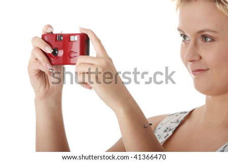 Portrait of a beautiful young woman talking a picture, isolated