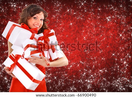 Portrait of a beautiful young woman wearing christmas clothes over sky of stars and snow.