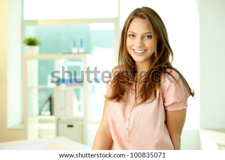Portrait of a beautiful young woman wearing smart casual clothes
