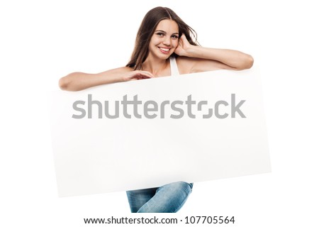 Portrait of a beautiful young woman with blank billboard isolated on white background