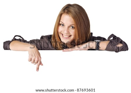 Portrait of a beautiful young woman with blank billboard on white background