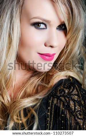 portrait of a beautiful young woman with curly blond hair and glamour make-up with pink lips