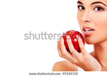Portrait of a beautiful young woman with fresh red apple. Isolated over white background.