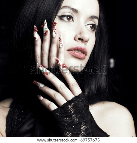 Lifestyle Stock-photo-portrait-of-a-beautiful-young-woman-with-long-designer-nails-69757675