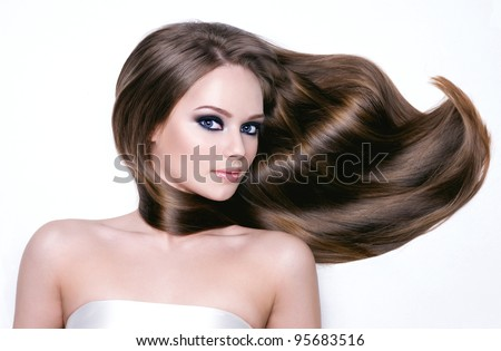 Portrait of a beautiful young woman with long hair and bright black eye make-up- horizontal