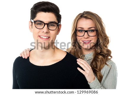 Portrait of a bespectacled young couple posing for a portrait.