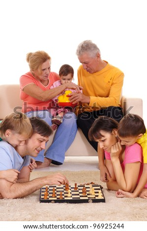 portrait of a big family playing chess