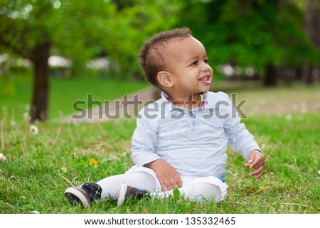 Portrait of a black african american baby boy playing  in the park - African children
