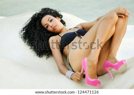 Portrait of a black woman with beautiful body wearing bikini