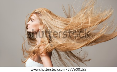 Portrait of a blond beauty with beautiful healthy long hair.