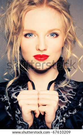Portrait of a blond lady with a beautiful hair and red lips