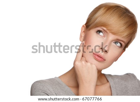 Portrait of a blond woman looking at copyspace, isolated on white background