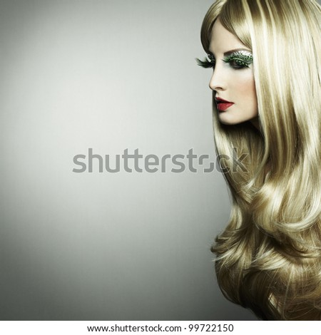 Portrait of a blond woman with long eyelashes. Fashion photo