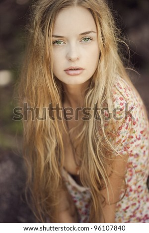 Portrait of a blonde girl with green eyes, a mermaid