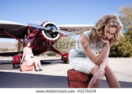 Portrait of a bored passenger, waiting for her flight. With a classic 1930's private plane