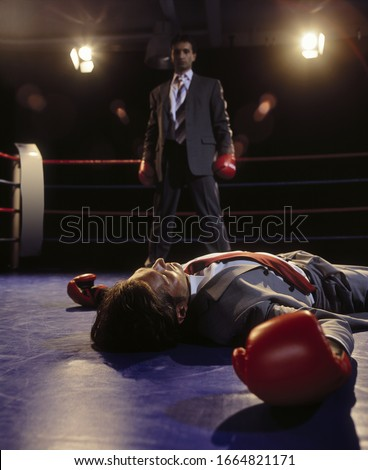 Portrait of a boxer sprawled on the floor of the ring out for the count