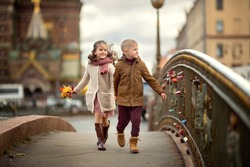 Portrait of a boy and a girl strolling through the autumn city. St. Petersburg. Russia