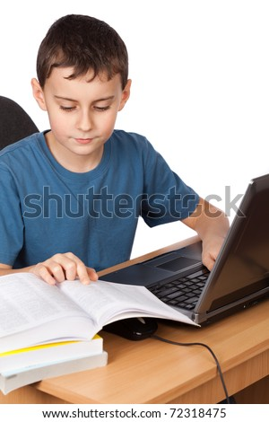 Portrait of a boy doing his homework at the laptop, isolated on white background - stock photo