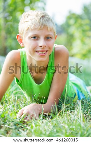 Portrait of a boy fourteen years of age in the grass #461260015