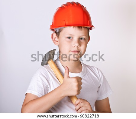 Portrait of a boy in a red protective helmet