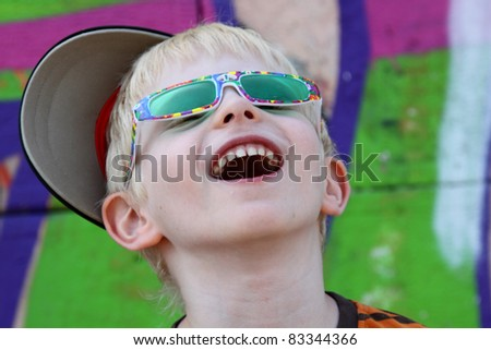portrait of a boy on a background of graffiti