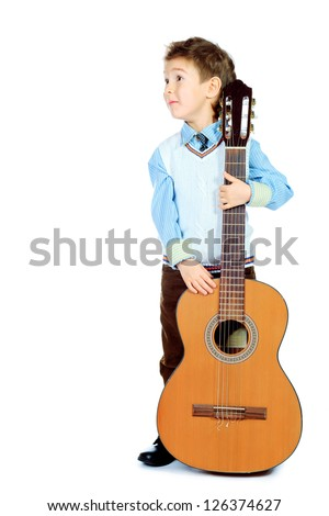 Portrait of a boy posing with his guitar. Isolated over white background.
