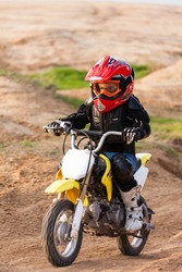 Portrait of a boy racer on a motorcycle in the desert