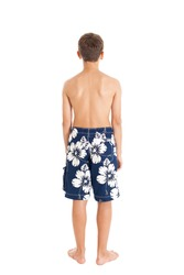 Portrait of a boy wearing swimming shorts. A boy stands with his back to the camera. Studio shot, isolated on white background.