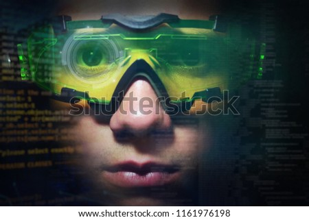 Portrait of a boy with green glasses from real professional gamer and on the graphic background in holography. Concept of: online games, future, technology #1161976198