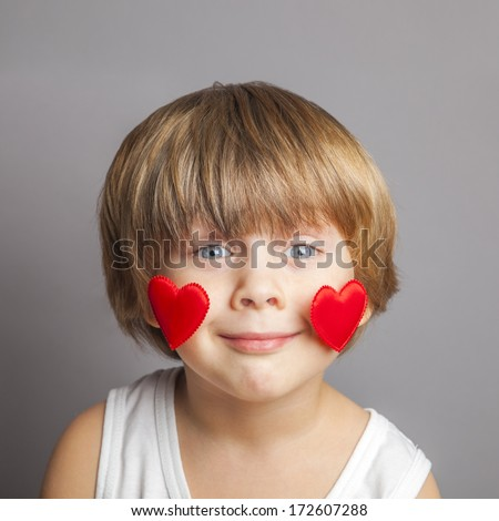 Portrait of a boy with hearts on face