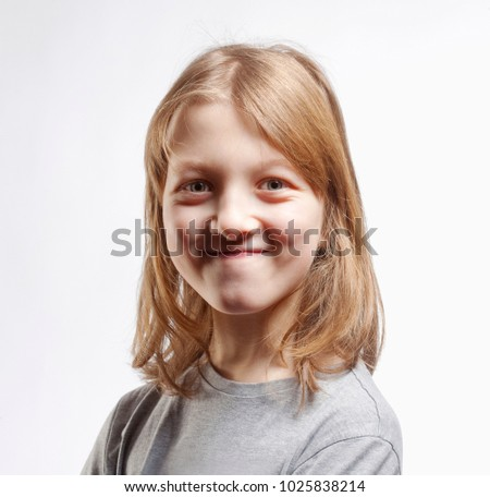 Portrait of a Boy with Long Blond Hair Looking  #1025838214