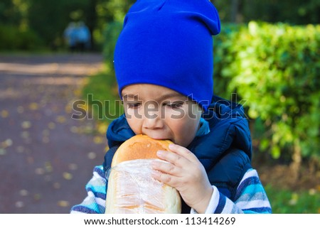 portrait of a boy with white bread