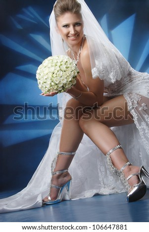 portrait of a bride with a veil and a bouquet of flowers