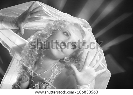 portrait of a bride with a veil on her face