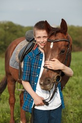 Portrait of a brown horse and boy