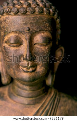 Portrait of a Buddha statue. Black background